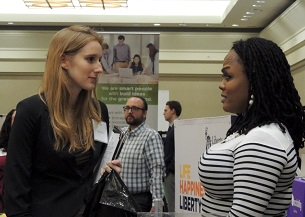 Photo of student talking with recruiter at career fair.